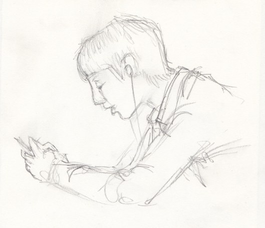 Boy texting — this young man was so engrossed that he barely moved during the time I took to sketch this, about five minutes.