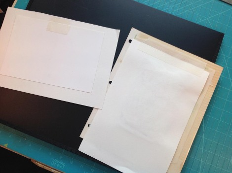 This shows how the tape is attached. The one on the left has the plate on top of the paper because it is smaller; the one on the right has the plate on the bottom because it is larger (and heavier, with the cardboard photo album page) then the paper. When they are open you just turn them so that you can work on the plate, so it doesn't really matter which one is on top.