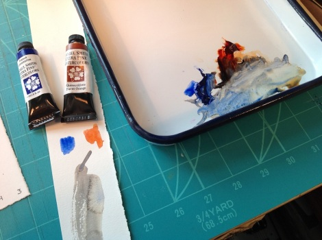 """French Ultramarine and Quinacridone Burnt Orange make a beautiful grey that approximates the colours of our local beaches. I put them next to each other on the palette (which is an enamelled """"Chinese butcher tray"""", and mix them in between, making them more blue or orange as the need arises."""