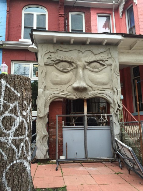 Not long after we entered the Kensington Market area, we came upon this strange addition to a porch. It seems like everyone in the neighbourhood is vying to come up with unconventional, arty things to do to their houses. Murals, colourful paint jobs, and sculptural oddities abound.