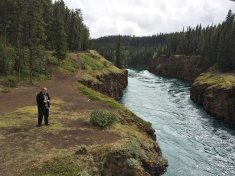 During our last few hours in Whitehorse, we got another whirlwind tour. This is Miles Canyon, which used to be the path of the rapids of the Yukon River before it was dammed. My friend Ken Steacy is kindly providing scale here.