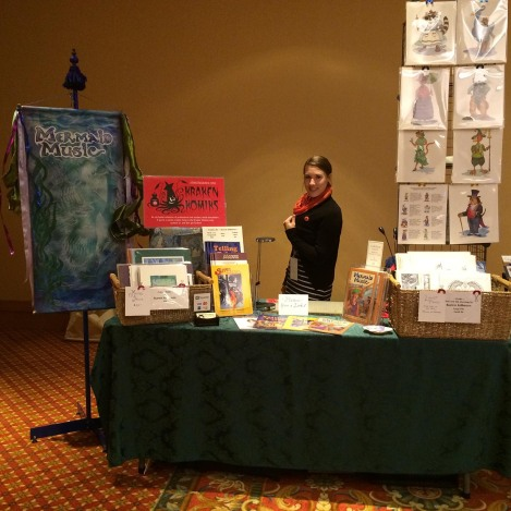 My trusty assistant, Kay, with the Tower of Prints we set up. We were back in the far, far corner of the hall, so needed the height to bring people back to look.