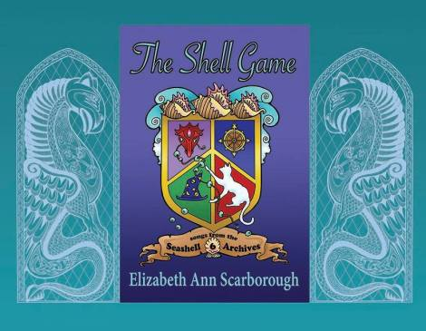 Annie designed the shield in her beading program (she's a very talented beadweaver as well as writer!) and I made it into a book cover using the banner and shell ornaments I designed for the series. The dragons on either side are from one of my Celtic pen and ink drawings.
